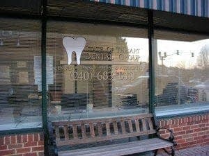 Sidewalk view of State of the Art Dental Group window which serves families from Gaithersburg, MD.
